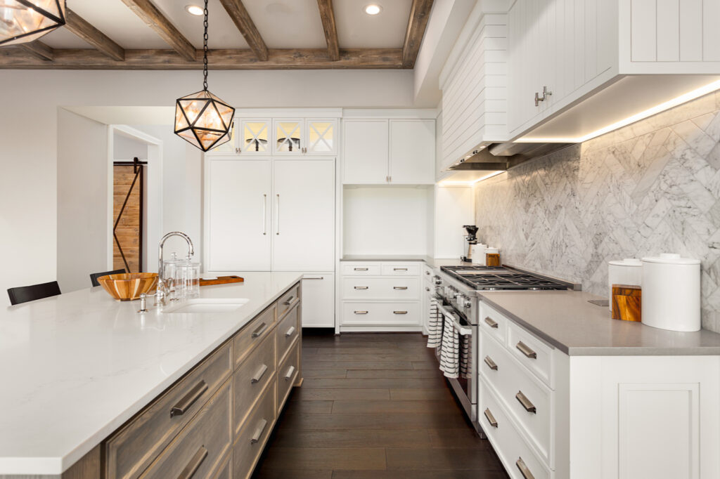large kitchen with island and exposed wood beams